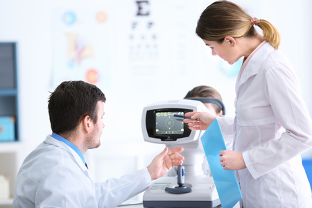 Two young doctors at medical office