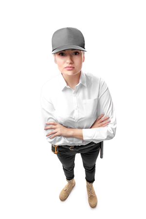 Female security guard on white background 免版税图像