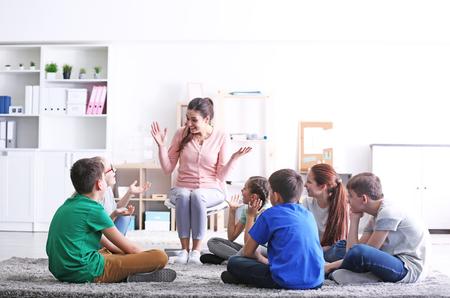 Female teacher conducting lesson at school