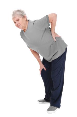 Elderly woman suffering from backache on white background Фото со стока