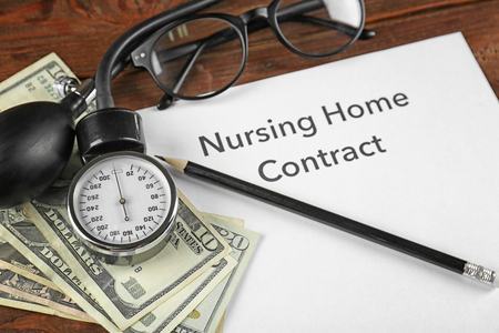 Nursing Home Contract on clipboard, closeup. Medical concept