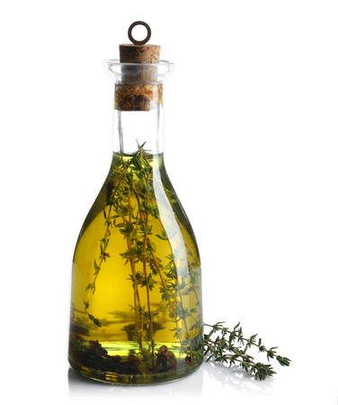 Olive oil with herbs, isolated on white
