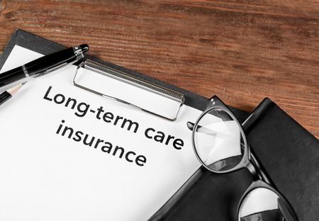 LONG TERM CARE INSURANCE information closeup. Medical concept 스톡 콘텐츠