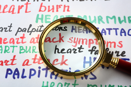 Magnifier on heart attack medical message background