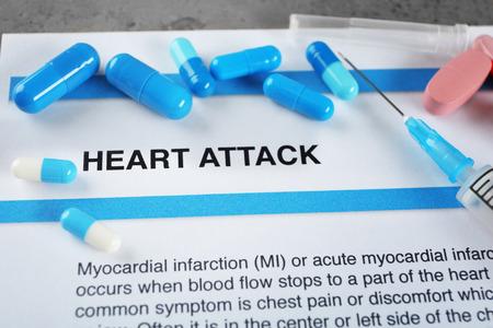 Diagnosis HEART ATTACK on medical report and medicines closeup
