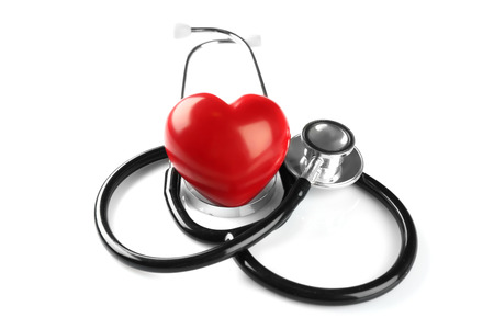 Stethoscope and red plastic heart isolated on white. Cardiology concept Stok Fotoğraf