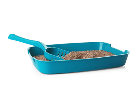 Plastic litter box with filler on white background Stock Photo