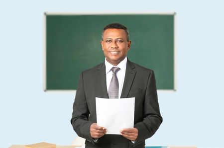 Confident Indian teacher in classroom