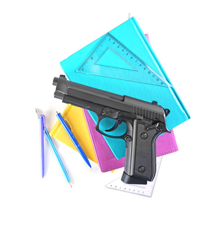 School stationery and gun isolated on white 免版税图像