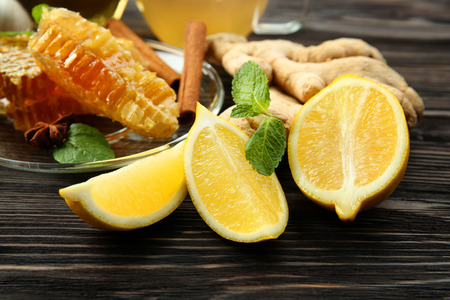 Natural ingredients for cough remedy on wooden table