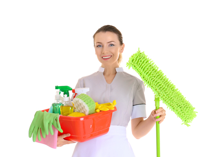 Beautiful chambermaid with cleaning equipment on white background Stock Photo