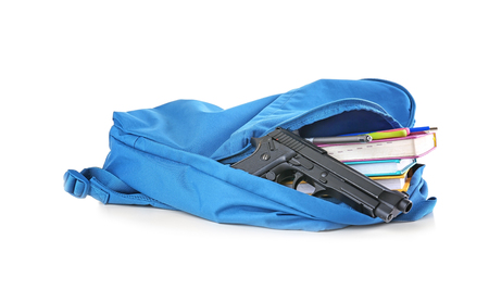 School backpack with books and gun on white background Stock Photo - 110139749