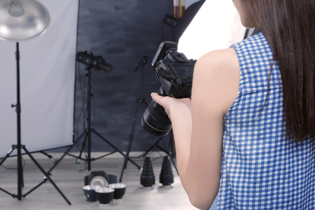 Young professional photographer with camera in studio 免版税图像 - 110140050