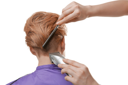 Hairdresser working with client on white background 스톡 콘텐츠