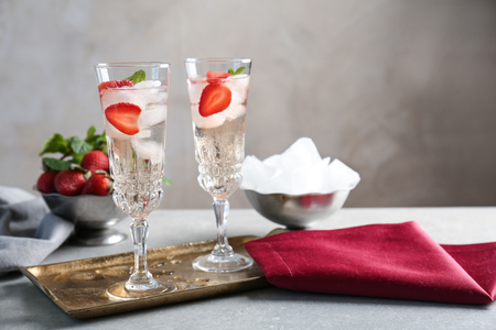 Glasses with delicious wine spritzer on golden tray