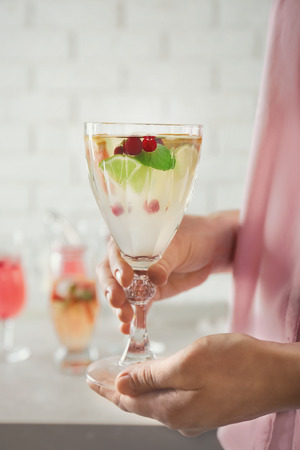 Woman holding glass of delicious wine spritzer Stock fotó