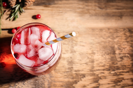 Glass of delicious wine spritzer on wooden table