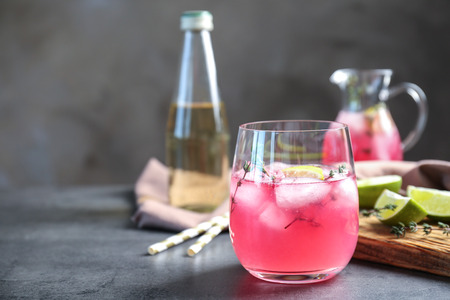 Glass with delicious wine spritzer on grey table Stock fotó