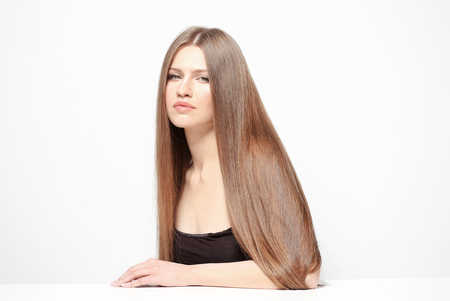 Attractive young woman with beautiful long hair on white background 스톡 콘텐츠