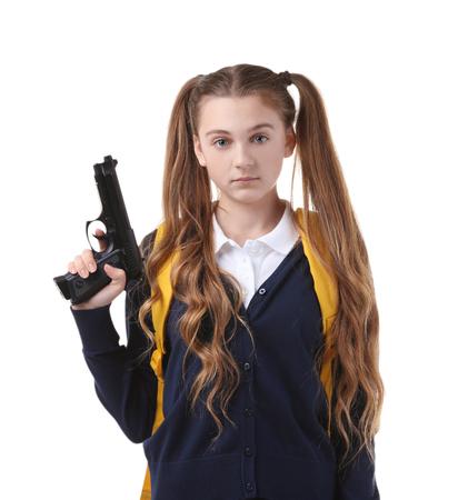 Teenage girl holding gun on white background