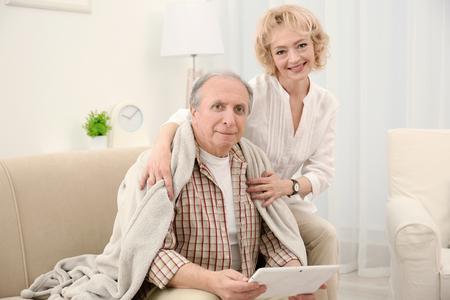 Portrait of happy senior couple at home Stock Photo