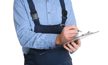 Plumber in uniform holding clipboard on white background Stock Photo