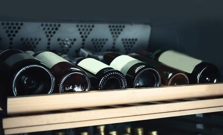 Wine bottles cooling in refrigerator