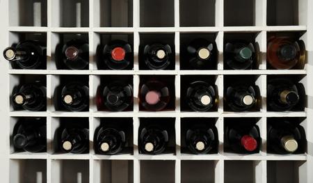Wine bottles on wooden racks in cellar
