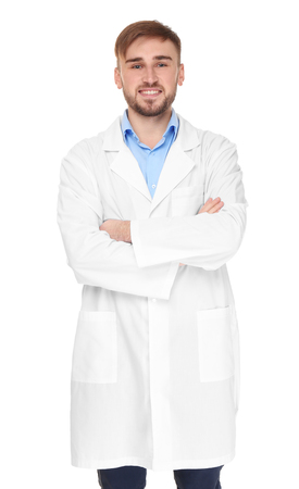 Handsome doctor with crossed hands on white background Foto de archivo