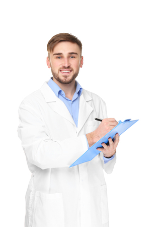 Handsome doctor with blue clipboard on white background 免版税图像