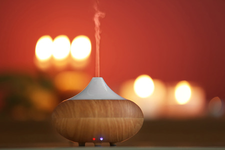 Aroma oil diffuser on blurred candlelight background Reklamní fotografie