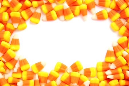 Colorful Halloween candy corns on white background Stockfoto