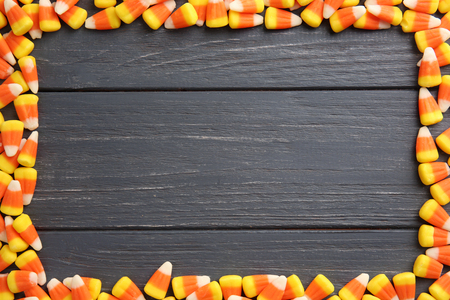 Colorful Halloween candy corns on wooden background Stockfoto