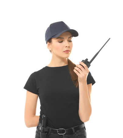 Beautiful young woman in security uniform on white background Stock Photo
