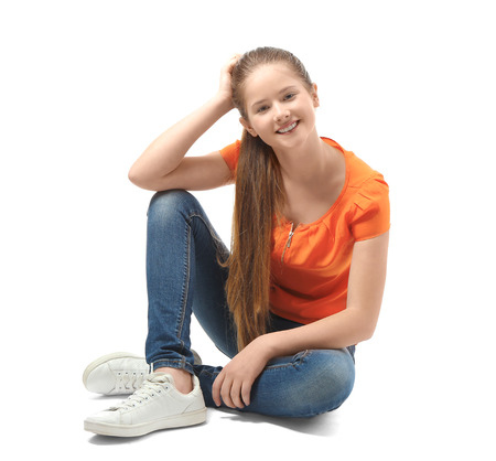 Pretty teenager girl posing on white background