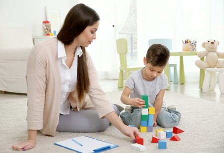 Young child psychologist working with little boy