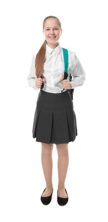 Cute girl in school uniform on white background 写真素材