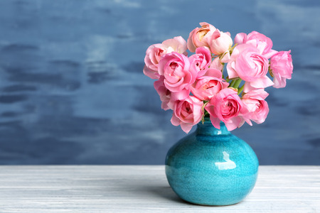 Vase with beautiful bouquet of ranunculus flowers on table Archivio Fotografico