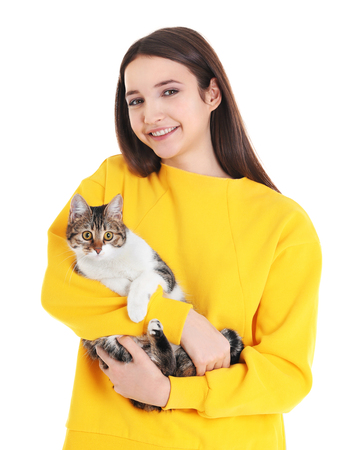 Beautiful young woman with cute cat on white background