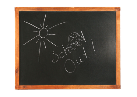 Schools out text on chalkboard, white background Stock Photo