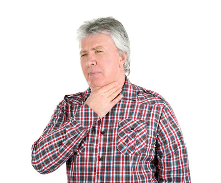 Sick senior man having pain in throat on white background Stock Photo