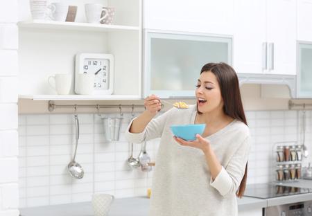 Beautiful pregnant woman in kitchen Stock fotó