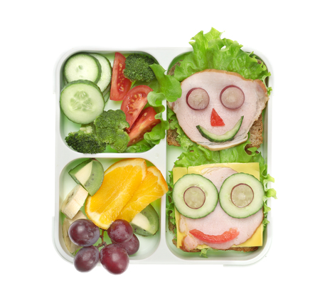 Lunch box with delicious food on white background