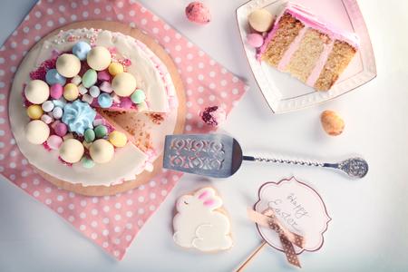 Sliced Easter cake on festive table Reklamní fotografie