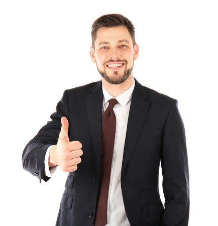 Handsome man in elegant suit showing thumb up on white background