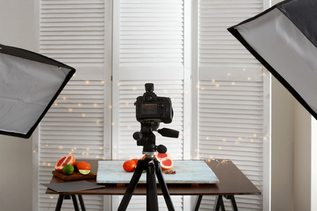 Professional camera on tripod while shooting food Stock Photo