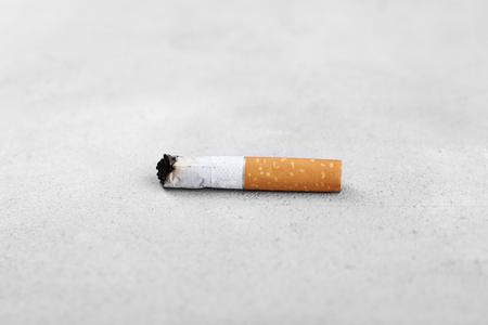 Cigarette butt on light background