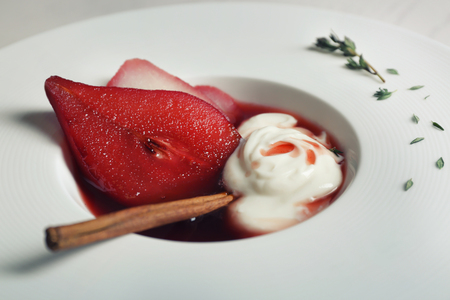 Delicious dessert with pears, closeup