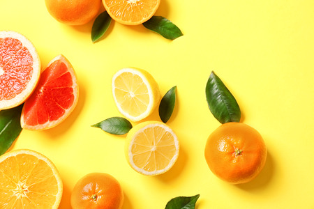 Juicy composition of tropical fruits on yellow background 写真素材