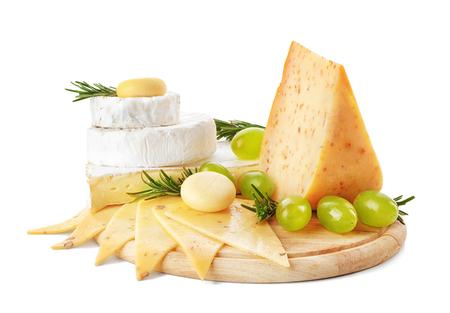 Wooden board with tasty cheese on white background Standard-Bild
